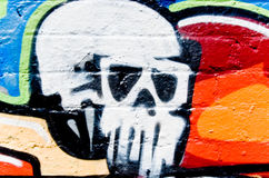 Graffiti:Skull on the  Wall. Graffiti:Fragment On The Textured Brick Wall Stock Photo