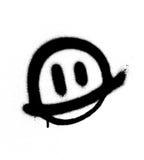 Graffiti smiling face emoticon in black on white. Graffiti smiling face emoticon in black over white Stock Photo