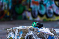 Graffiti spray can. In front of graffiti wall Stock Image