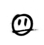 Graffiti sprayed face emoticon in black on white Royalty Free Stock Images