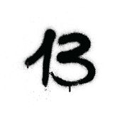 Graffiti sprayed number 13 thirteen in black over white Royalty Free Stock Photography