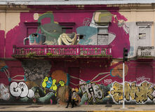 Graffiti spread over two stories of house. Royalty Free Stock Image