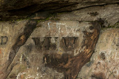 Graffiti in St Cuthberts Cave, Northumberland. England.UK. The cave were medieval monks were said to have hid St Cuthberts body from marauding vikings. Graffiti Royalty Free Stock Photo
