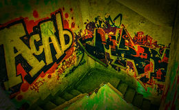 Graffiti on the stairs III. Graffiti on the stairs, abandoned hospital, Madrid, Spain stock image