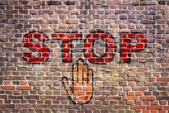 Graffiti stop letters hand brick wall royalty free stock image