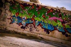 Graffiti street art. Roadside wall tagged with colorful graffiti street art Royalty Free Stock Images