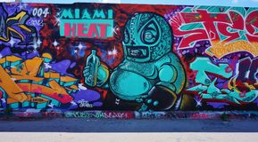 Graffiti street art in the Wynwood neighborhood of Miami. MIAMI, FLORIDA --OCTOBER 2014-- Colorful graffiti art line the street walls and back alleys of Miami Stock Images