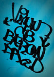 Graffiti style artist on ground. Graffiti style artist on blue color background Royalty Free Stock Photos