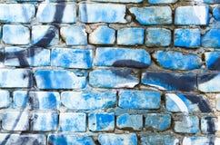 Graffiti su un muro di mattoni Immagine Stock Libera da Diritti
