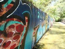 Graffiti sulla parete del canale Fotografia Stock