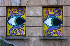 Graffiti sulla parete - occhi Fotografia Stock