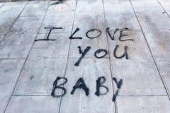 Graffiti sur le bébé de trottoir je t'aime Images libres de droits