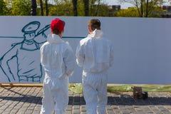 Graffiti sur le mur blanc Photos libres de droits
