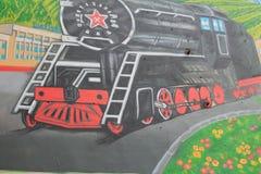 Graffiti sur le mur d'un bâtiment Photos stock