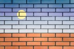 Graffiti sur un mur de briques photos stock