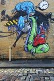 Graffiti surreali su una parete della città Immagine Stock Libera da Diritti