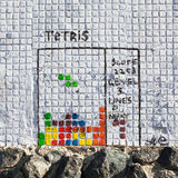 Graffiti tetris game. Graffiti, tetris game painted on tile facing of a building Stock Images