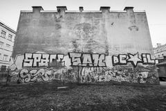 Graffiti with text on old house wall Royalty Free Stock Photo
