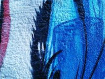 Graffiti texture. Blue, black and white graffiti art on wall Stock Photos