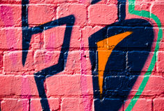 Graffiti on the textured brick wall Royalty Free Stock Images