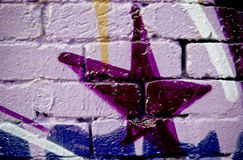 Graffiti on the textured brick wall Royalty Free Stock Photos