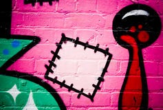 Graffiti on the textured brick wall. Detail of Graffiti on the textured brick wall Royalty Free Stock Photos