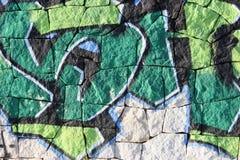 Graffiti on tiled brickwork. Green Graffiti on tiled brickwork wall in Spain royalty free stock photo