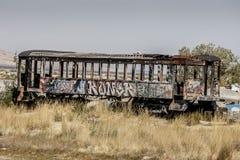 Graffiti on a train car, Salt Lake City, Utah. A grafitti covered abandoned train car near the Great Salt Lake, near Salt Lake City, Utah Royalty Free Stock Images