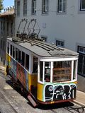 Graffiti tram Portugal. A tram in the street of Lisbon. Portugal. In this line tram are usually full of graffiti Royalty Free Stock Images