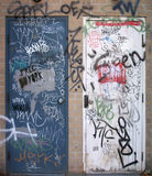 Graffiti on two doors Royalty Free Stock Photos