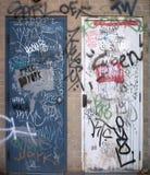 Graffiti on two doors Royalty Free Stock Photos