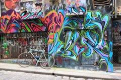 Graffiti und Fahrrad in Melbourne Lizenzfreies Stockfoto