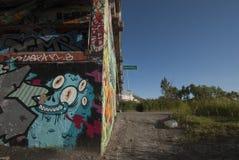 Graffiti under a bridge coming into Montreal Stock Photos