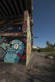 Graffiti under a bridge coming into Montreal Stock Image