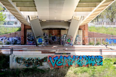 Graffiti under the Ponte della Musica, a modern white steel brid Royalty Free Stock Photography