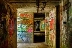 Graffiti in underground concrete building in state park stock image
