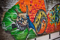Graffiti of unidentified artist on the wall Stock Photography