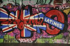 Colourfull graffiti on a wall in The Southbank Skating Park,London. Graffiti of the Union Jack and the word Latinos decorates one wall of The Undercroft Royalty Free Stock Photo
