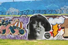 Graffiti van de Kleine zendingen van Biggie in Lissabon. Stock Foto's