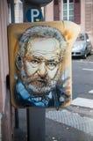 Graffiti of Victor Hugo on mailbox stock images