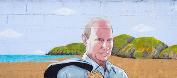 Graffiti Vladimir Putin. RUSSIA, CRIMEA, SUDAK, SUNNY VALLEY - MARCH, 03 2017: Graffiti on which the president of Russia Putin. In the background is the stock photo