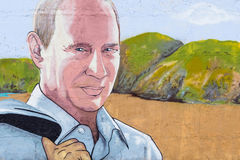 Graffiti Vladimir Putin. RUSSIA, CRIMEA, SUDAK, SUNNY VALLEY - MARCH, 03 2017: Graffiti on which the president of Russia Putin. In the background is the royalty free stock photos