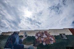 Graffiti von Blumen und von Körper Lizenzfreie Stockfotografie