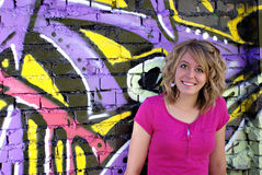 Graffiti Wall. A beautiful young woman leaning against a wall covered in graffiti Stock Images