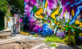 Graffiti on a wall and an air pump at a gas station in Little Fi Royalty Free Stock Photography