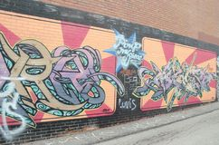 Graffiti on wall in alley Royalty Free Stock Image