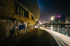 Graffiti on a wall along the Danube Canal at night, in Vienna, A Royalty Free Stock Images