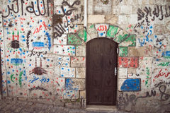 Graffiti on the wall in the Arab block of old city Royalty Free Stock Photo