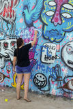 Graffiti Wall and Artist. Austin Texas. Graffiti Artist at Hope Outdoor Gallery in Austin Texas.  An open call to paint freely in an urban artists friendly way Royalty Free Stock Photos