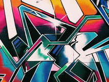 Graffiti wall background. Urban street art stock photography
